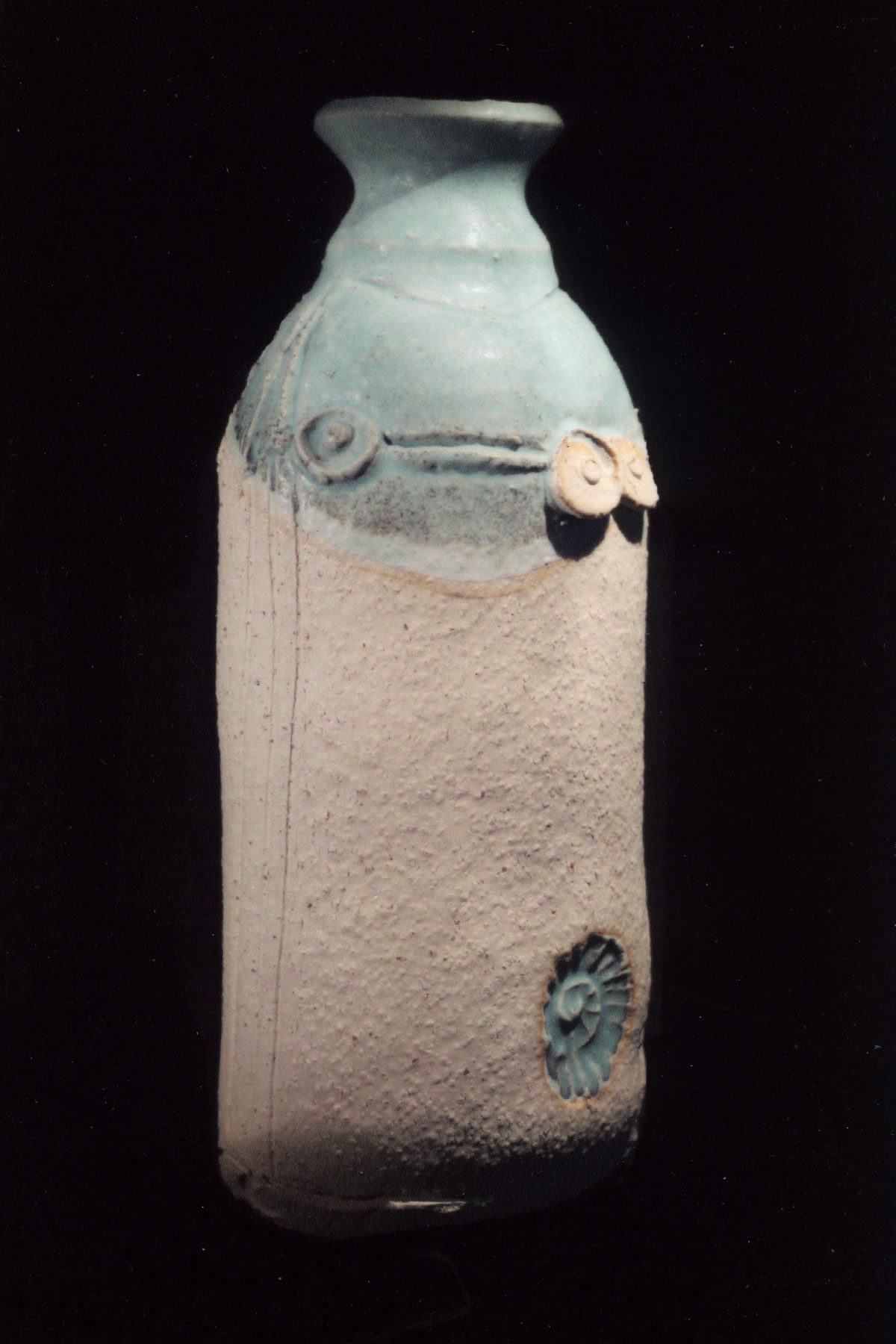 Stoneware bottle ceramic with ammonite motif by East Yorkshire ceramicist Stewart Taylor