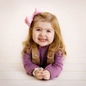 Cute studio portrait photography of little girl