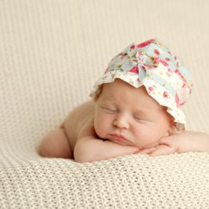 Sleeping newborn in hat